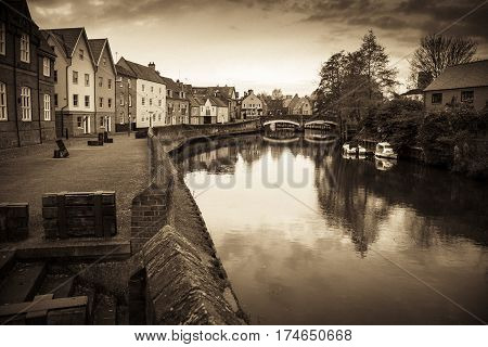 Classic Norwich riverside scene with sepia treatment