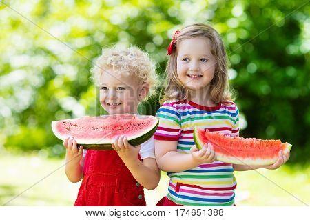 Kids Eating Watermelon In The Garden