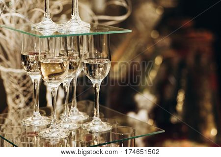 Elegant Champagne Glasses Catering, Tiered Alcohol Drinks On Glass Table, Business Dinner Party Rece
