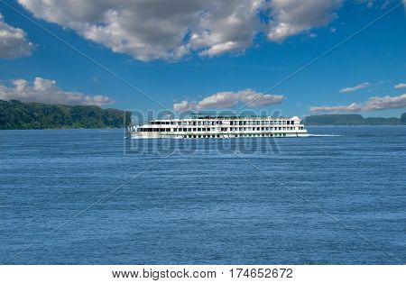 Passenger cruise ship tour boat cruising boating along Danube River in Europe. River Transport.