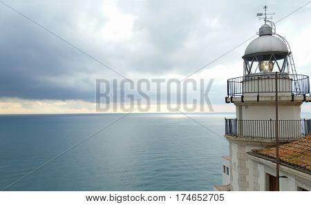 Sea lighthouse on village in Peniscola, Castellon Spain