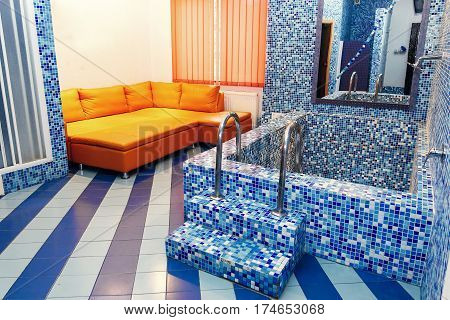 Luxury Whirlpool Bathtub In Elegant Recreation Room In Rehabilitation Center, Blue Tile Flooring, Re