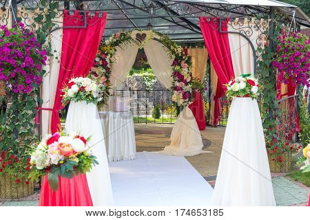 wedding ceremony decorations pink. Flowers decoration wedding ceremony.
