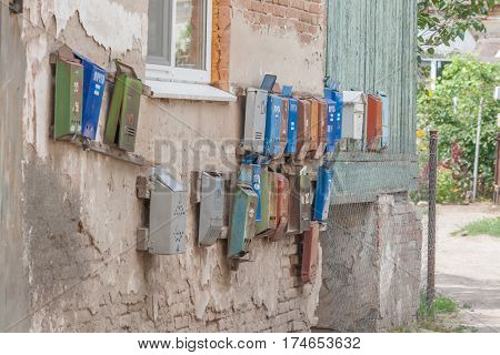 Few old mailboxes hanging on the wall