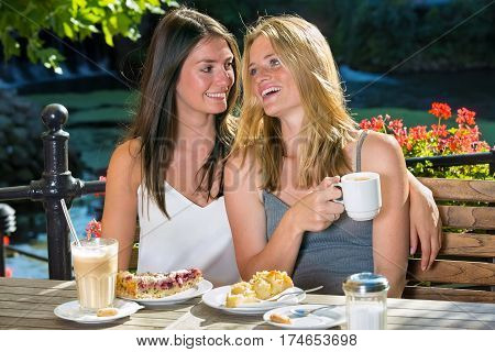 Two Close Female Friends In Outdoor Cafe