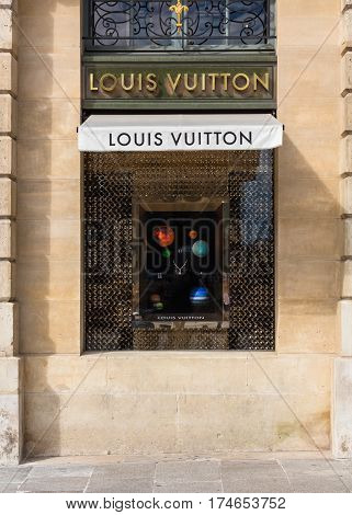 Paris France - July 02 2016: Louis Vuitton shop window in place Vendome in Paris. Louis Vuitton or shortened to LV is a French fashion house founded in 1854 by Louis Vuitton