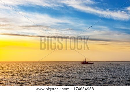 Lone tugboat at sea in the morning.