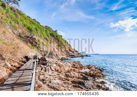 Beautiful seascape with rocks and meadow in cloudy blue sky at Khao Leam Ya National Park Rayong province Thailand