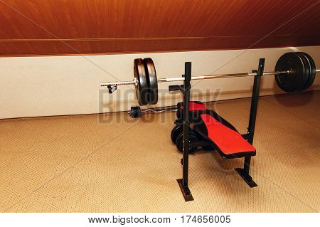 Barbell weight at weightlifting station in recreation room at rehabilitation center in hospital room healthy sport equipment fitness lifting concept