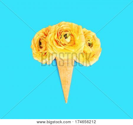 Ice Cream Cone With Flowers Over Colorful Blue Background Top View