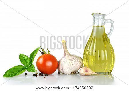 Sunflower oil in decanter and fresh vegetables