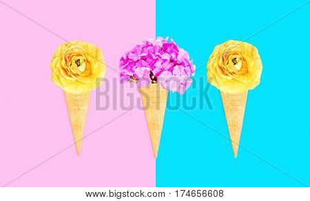 Three Ice Cream Cone With Flowers Over Pink Blue Colorful Background Top View