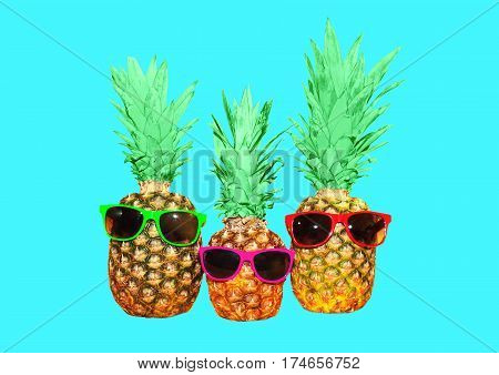 Three Pineapple With Sunglasses On Blue Background, Colorful Ananas Photo