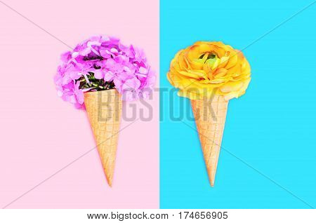 Two Ice Cream Cone With Flowers Over Colorful Pink Blue Background Top View