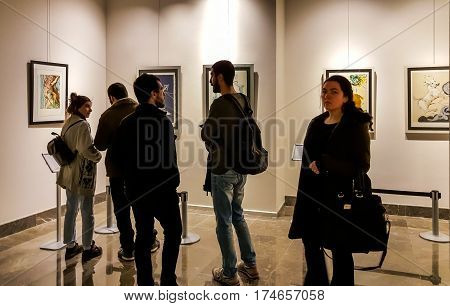 Eskisehir Turkey - March 4 2017: People attending a Salvador Dali exhibition at Contemporary Art Gallery