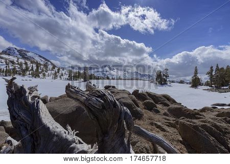 Carson Pass Snow - An alpine lake in the dead of winter in the Sierra Nevada on the pacific crest trail.
