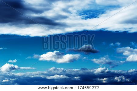 Beautiful blue background of a blue sky with different clouds