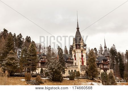 Beautiful View Of Peles Castle From Sinaia In Winter. Romania