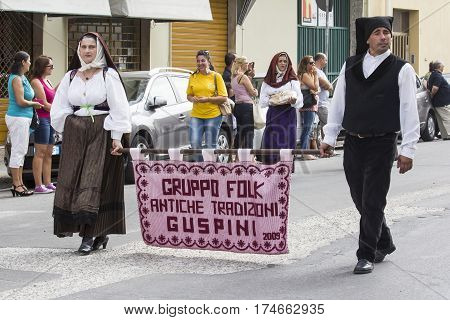 QUARTU S.E. ITALY - September 21 2014: Parade of Sardinian costumes and floats for the grape festival in honor of the celebration of St. Helena - Parade of folk group traditions of Guspini - Sardinia