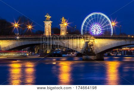 The bridge (Pont) des Invalides at night Paris France. The bridge is constructed for the upcoming 1855 World Fair in Paris.