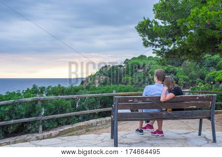 Young couple meeting the sunset in Lloret de Mar, Girona, Catalonia, Spain