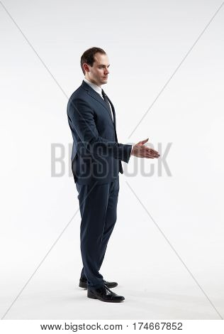 Portrait of a mature businessman in a suit make a deal isolated on white background