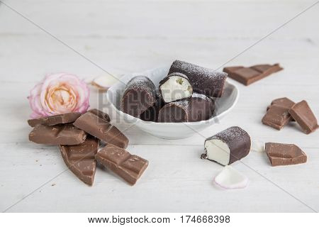 Chocolate and curd cheese at wooden background