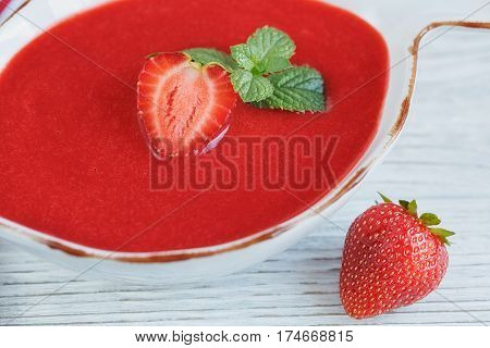 A bowl of strawberry soup gazpacho with mint. Healthy food.