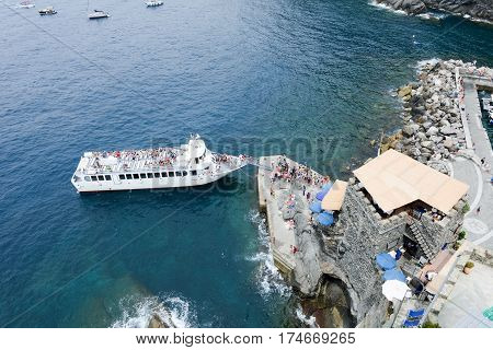Vernazza Italy - 8 July 2015: people boarding the turistic boat at the harbor of Vernazza on Cinque Terre Italy