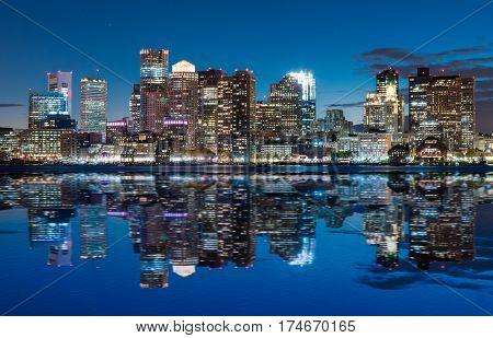 Boston skyline at dusk from across the harbor.