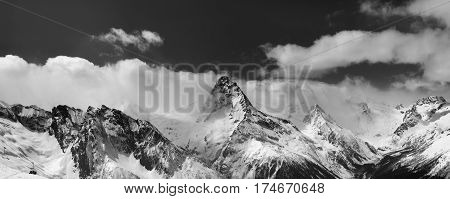 Black And White Panorama Of Snowy Mountains In Clouds
