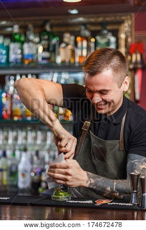 The Bartender Making Cocktail
