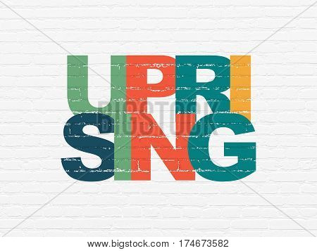 Political concept: Painted multicolor text Uprising on White Brick wall background