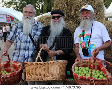 Moscow, Russia - 19 Aug, 2014: Three Elderly Farmers On Apple Savior Feast - Eastern Slavic Folk Hol