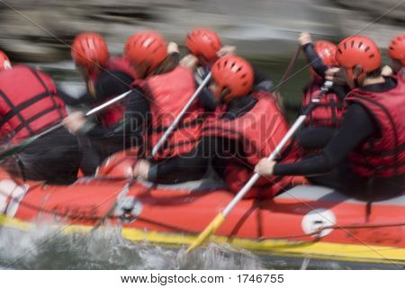 Red Rafting Team On Whitewater