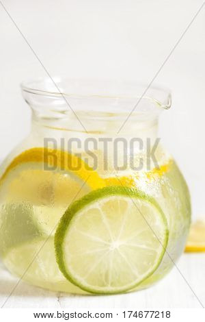 Detox drink with lemon in a jug