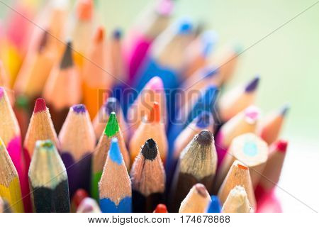 Colorful background made of bunch of wooden pencils in a wide variety of color palette as artistic office school education and creativity concept