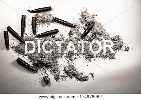Dictator word written in grey ash dirt dust with bullets around as dictatorship power war revolution tyranny bad government or political system concept lent background