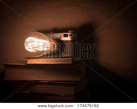 Vintage lamp with old books. Beige scratched background