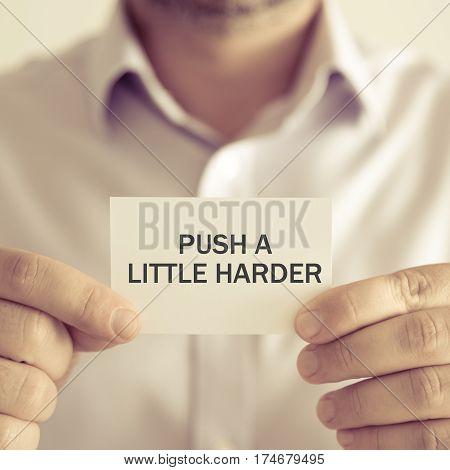 Businessman Holding Push A Little Harder Message Card