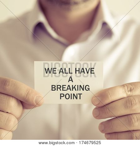 Businessman Holding We All Have A Breaking Point Message Card