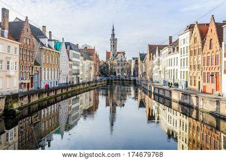 GHENT, BELGIUM - JANUARY 29, 2017: Reflection of church in Jan Van Eyckplein in the UNESCO World Heritage Old Town of Bruges Belgium