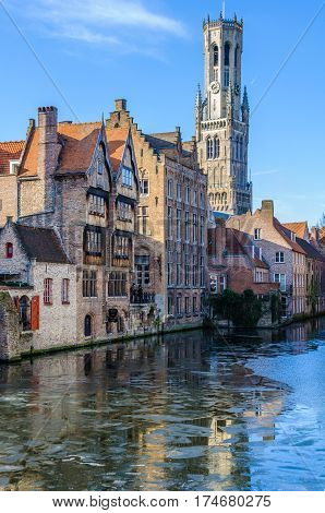 GHENT, BELGIUM - JANUARY 29, 2017: Reflection of medieval buildings in the UNESCO World Heritage Old Town of Bruges Belgium