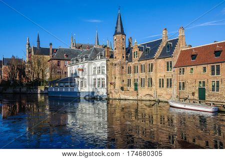 GHENT, BELGIUM - JANUARY 29, 2017: Reflection in the frozen canal in the UNESCO World Heritage Old Town of Bruges Belgium