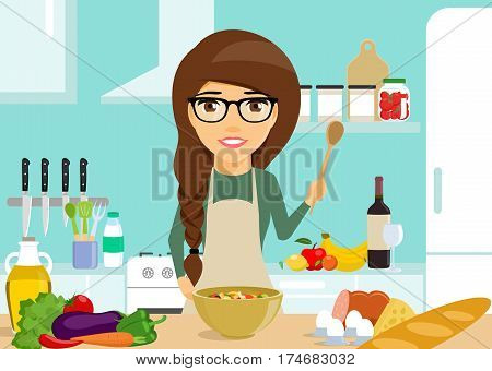 The young girl engaged in cooking. The concept of cooking. Vegetables and fruits. A girl holding a spoon in his hand. Happy girl