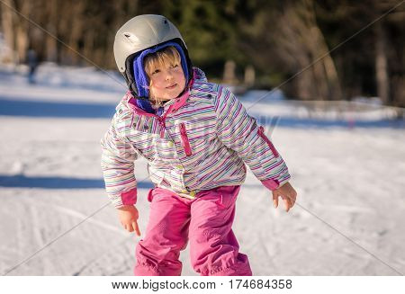 Little girl skiing unassisted for the first time