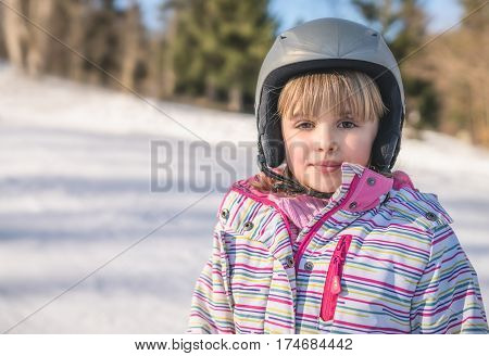 Portrait of a little girl after her first skiing lesson
