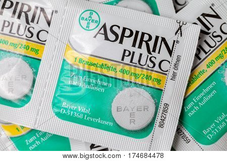 LANDESBERGEN / GERMANY - MARCH 5 2017: Aspirin plus C headache pills lies on brown background. Aspirin also known as acetylsalicylic acid is a medication used to treat pain fever and inflammation