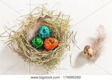 Colourfull Eggs For Easter On Old White Table
