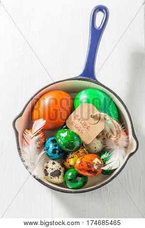 Colourfull Easter Eggs In Blue Pan On White Table